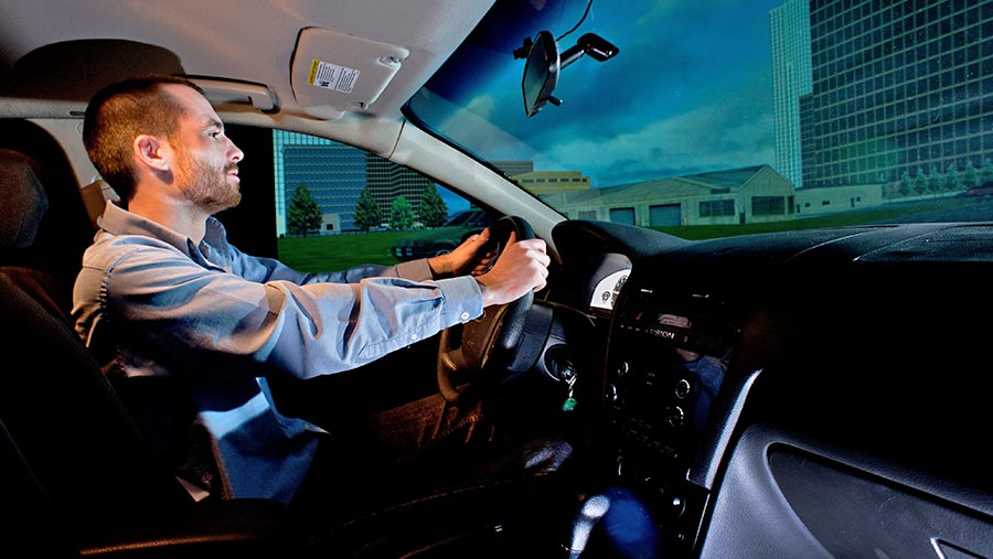 Engineering researcher in driving simulator