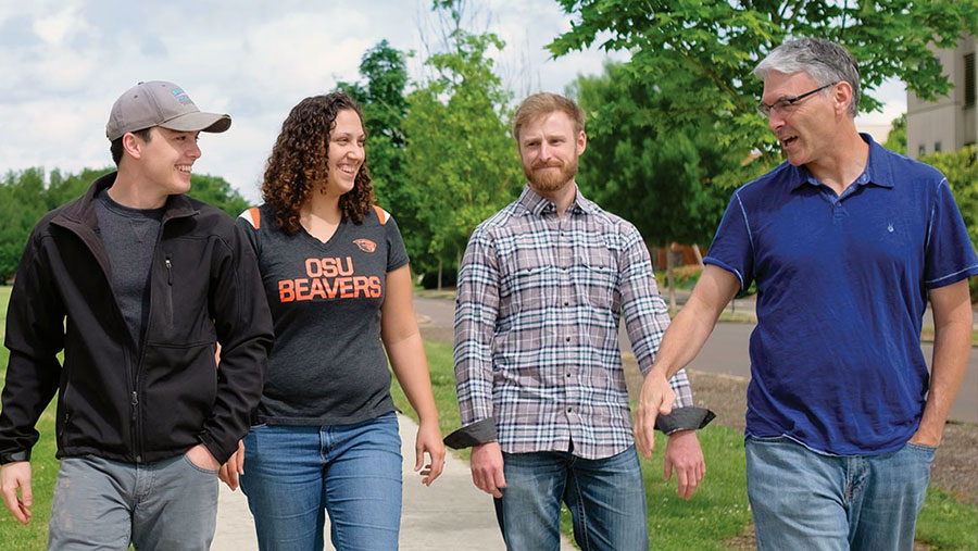 Oregon State faculty and students walking across campus