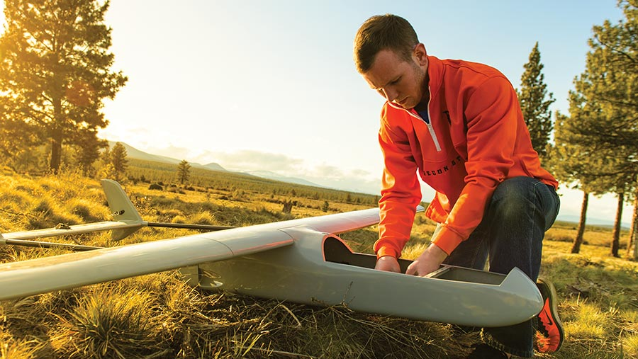 Oregon State Engineering student working in the field