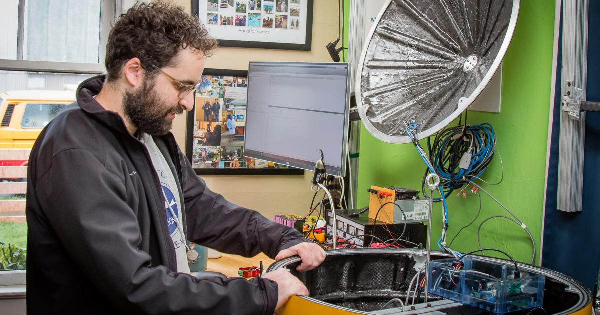 Max Ginsburg works on the Aquaharmonics wave energy device prototype