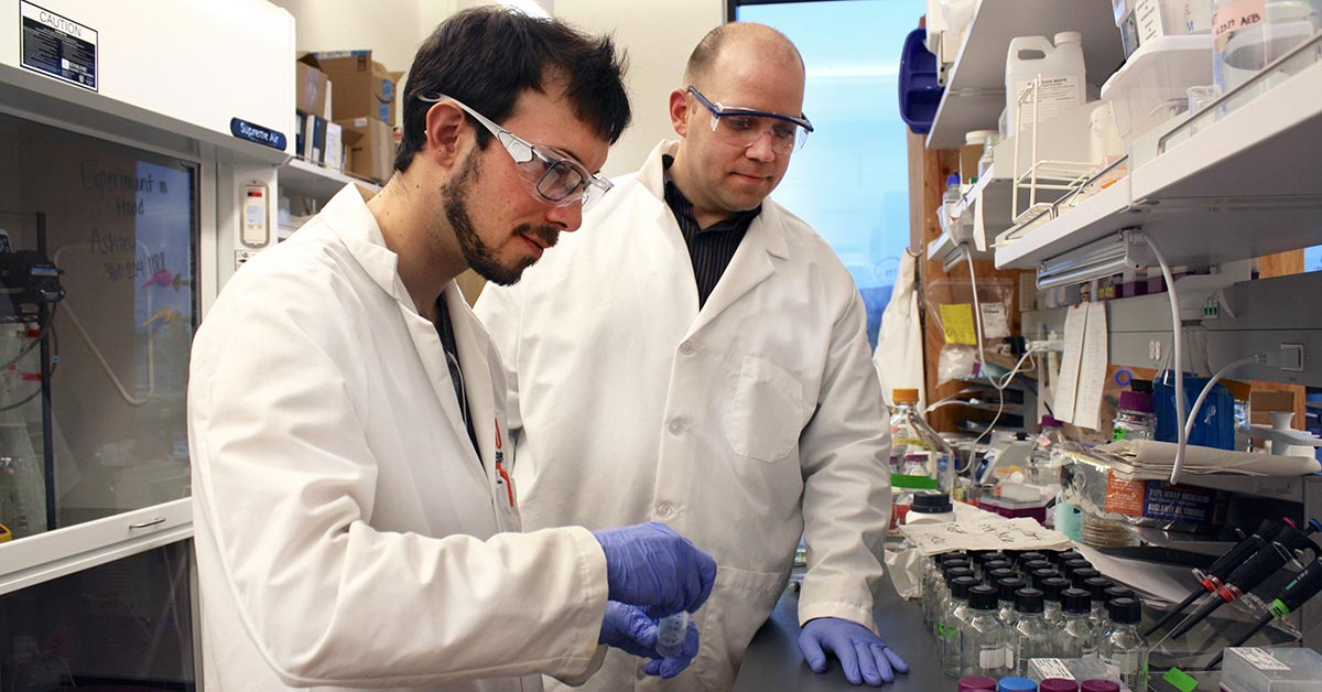 Tyler Radniecki, assistant professor of environmental engineering, and Ph.D. student Rich Hilliard measure nitrate concentrations in water samples undergoing anammox (anaerobic ammonia oxidation), a biologically based technology for cleaning up wastewater.
