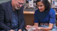 Two engineering researchers working in lab